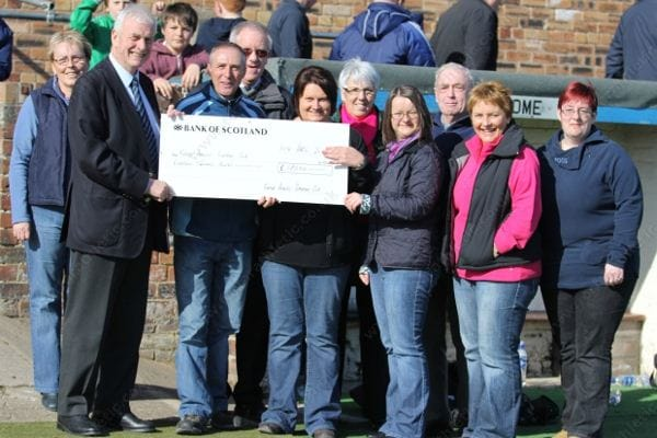 Supporters Club Cheque Presentation to Neill Wilson